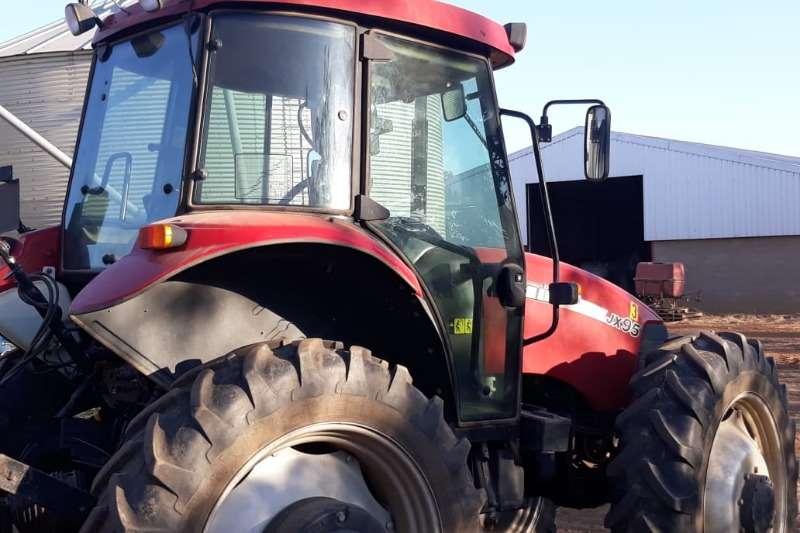 Case Row crop tractors CASE JX95 CAB HC   4WD Tractors