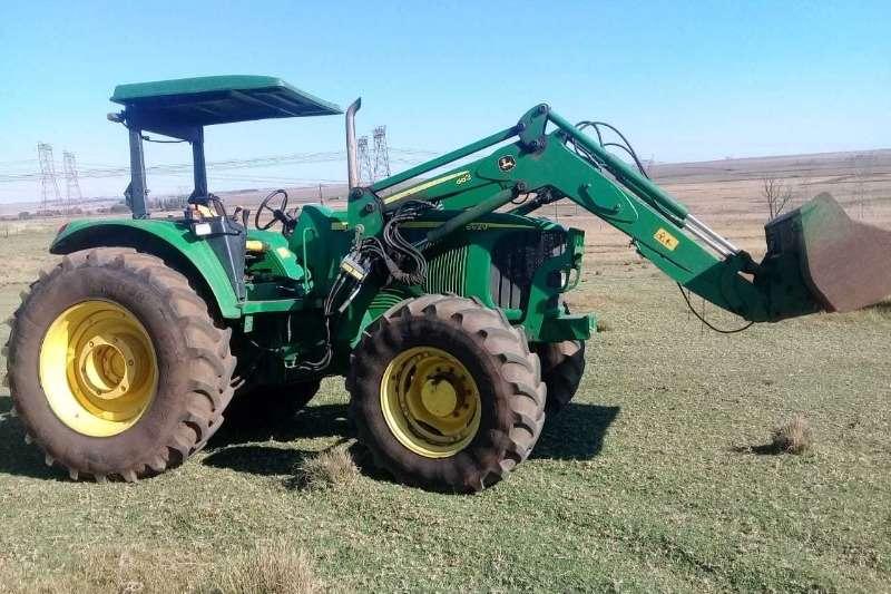 John Deere Tractors John Deer 6620 Met JD Laaigraaf