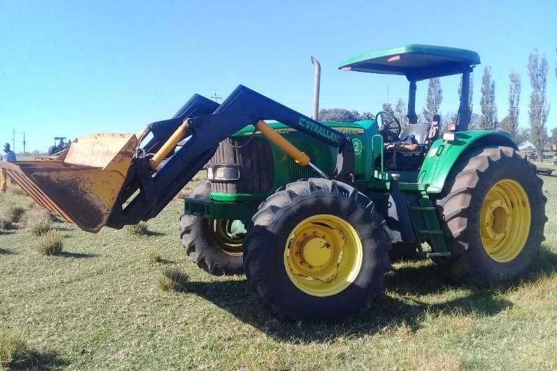 John Deere Tractors John Deer 6620 met Staaland laaigraaf