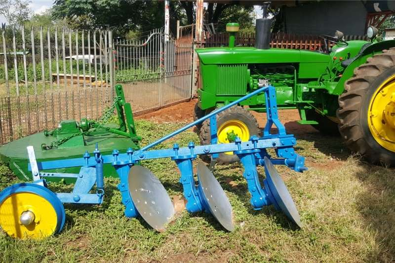 Other tractors 2130 John Deere with Bushcutter and 3 Disc Plough Tractors