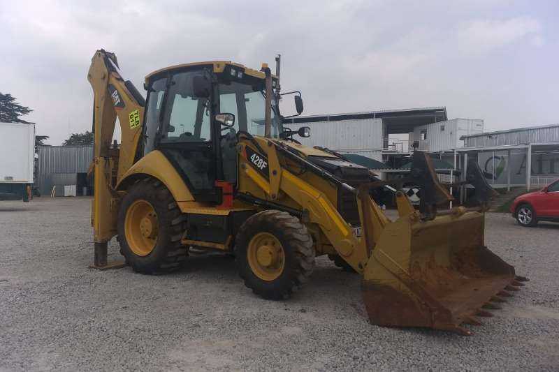 Caterpillar TLBs 428F With forks on bucket 2012
