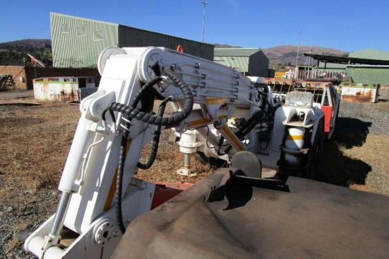 Komatsu Rock truck Bird Machines Scaler   Rock Breaker