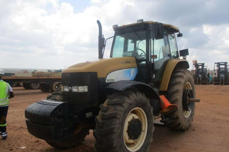 Other Tractors - towing New Holland TM7030 Tractor