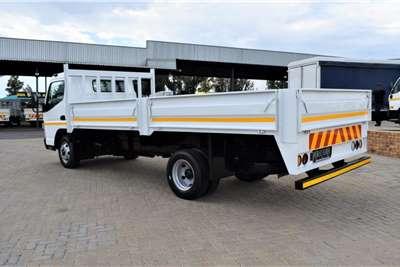 Fuso Canter FE7 150 Auto Dropside trucks