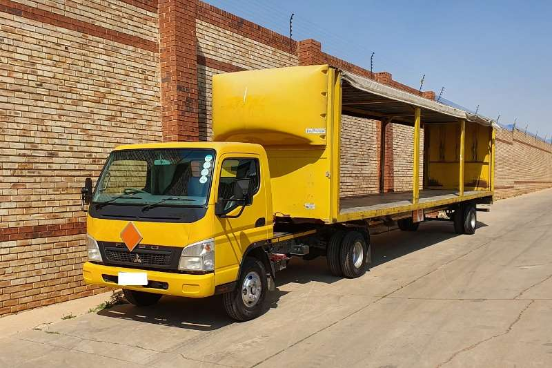 Fuso Truck-Tractor Single axle 7 136 PONI WITH 2010 LCM 12m TAUTLINER TRAILER 2010