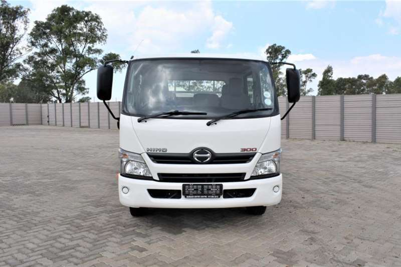 Hino 300 Series 815 LWB Crew Cab Drop Side Auto Truck