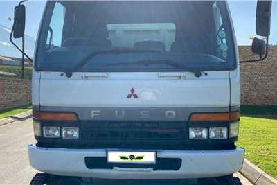 Mitsubishi 2007 Mitsubishi Fuso FM16 253 Dropside trucks