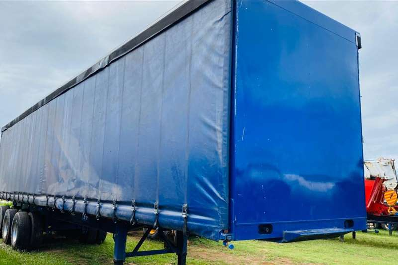 Motor Trail Trailers Tautliner 2 x Motortrail Tri Axle Tautliner Trailer