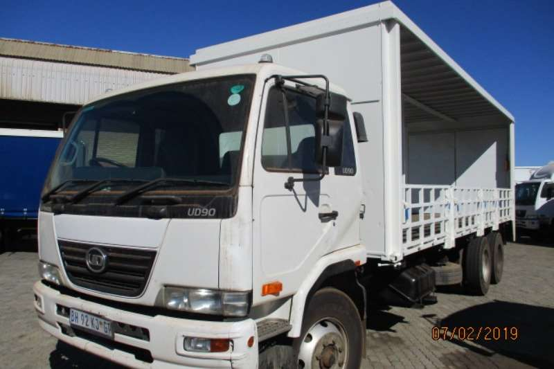 Nissan Nissan UD90 6 X 2 TAUTLINER WITH DROPSIDE/ TAILIFT Curtain side trucks