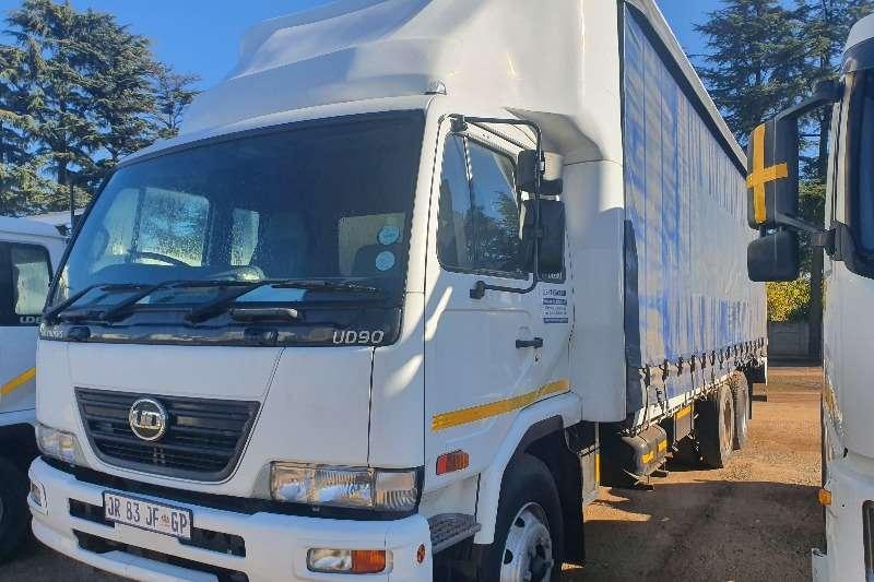 Nissan NISSAN UD90 TAG AXLE 12 TON Curtain side trucks