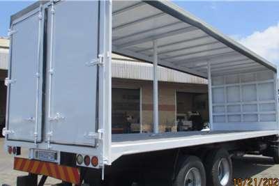 Nissan UD100 6 X 2 TAUTLINER Curtain side trucks