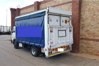 Nissan UD40,4 TON FITTED WITH TAUTLINER BODY AND TAILLIFT Curtain side trucks