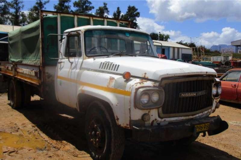 Nissan Dropside trucks UG780 1989