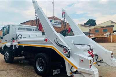 Nissan PKE 250 Skip bin loader trucks