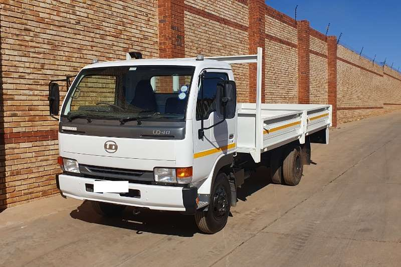Nissan Truck Dropside UD40,4 TONNER WITH DROPSIDE BODY,CHOICE OF 2 2011