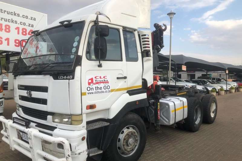 Nissan Truck-Tractor Double axle 2005 Nissan UD440 6 x 4 T/Tractor with 19ton crane 2005