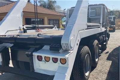 Nissan UD290 Skip Loader Truck