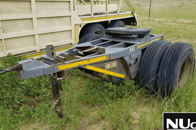 Other Trailers UNIQUE TRAILERS SINGLE AXLE DOLLY (BOX BODY)