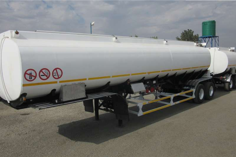 Tank Clinic Trailers Fuel tanker Semi and Pup 2006