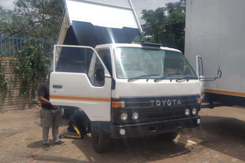 Toyota Tipper trucks Toyota Dyna Tipper with dropside doors.