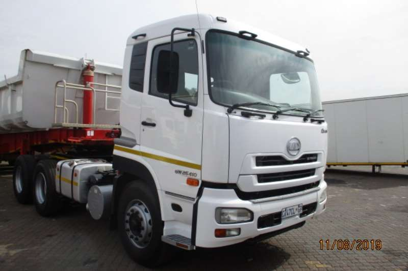 UD Truck-Tractor Double axle UD QUON GW26 410 6 X4 WITH END TIP TRAILER 2013