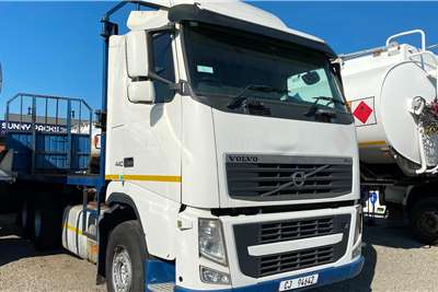 Volvo FH 440 With A Flatdeck Trailer Truck tractors